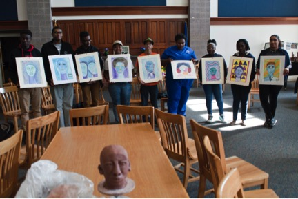 Youth leaders display their watercolors.